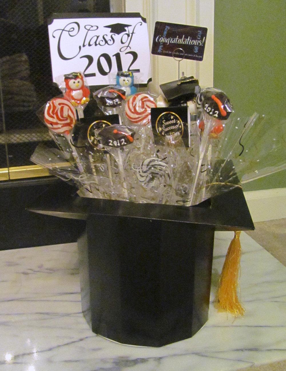 Graduation candy centerpiece featuring mortar board box on